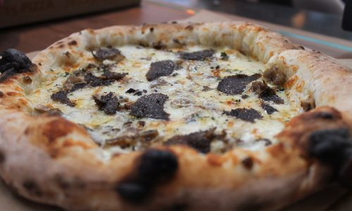 10 Strange and Delicious Regional Pizza Toppings You Need To Try Next Time You Are Travelling